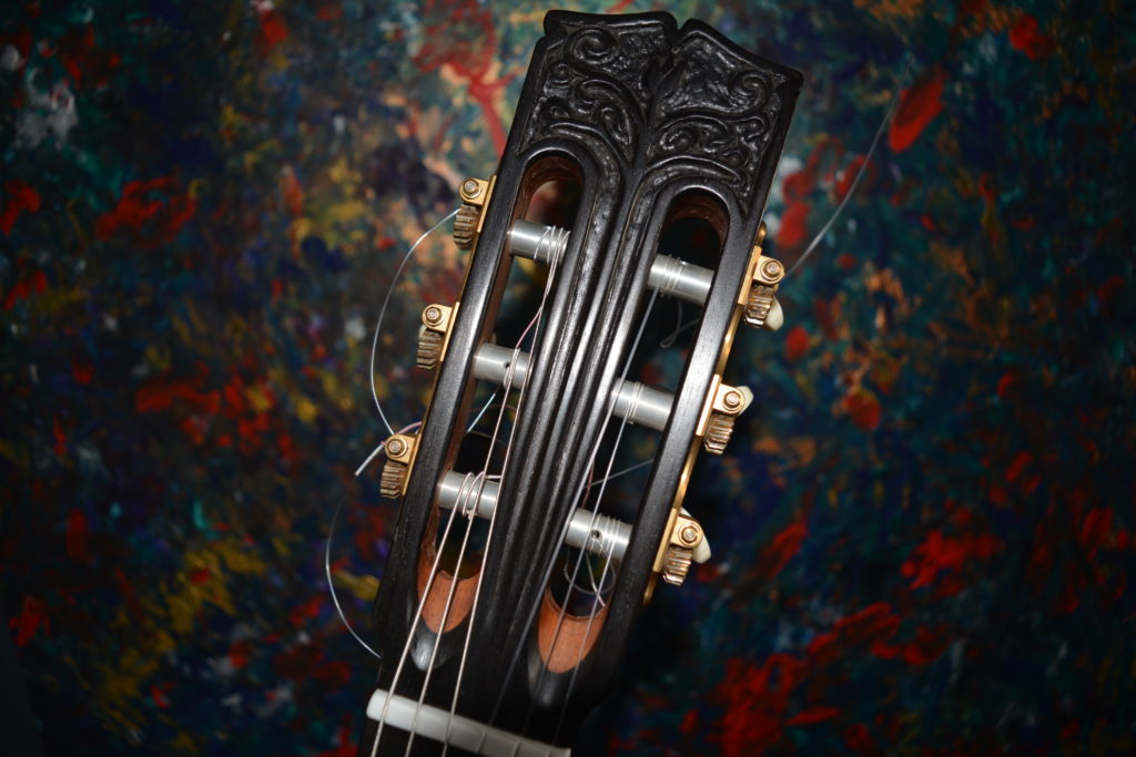 Carved Ebony headstock